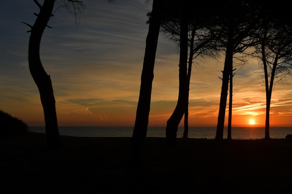Sonnenuntergang durch Baueme Meer Portugal