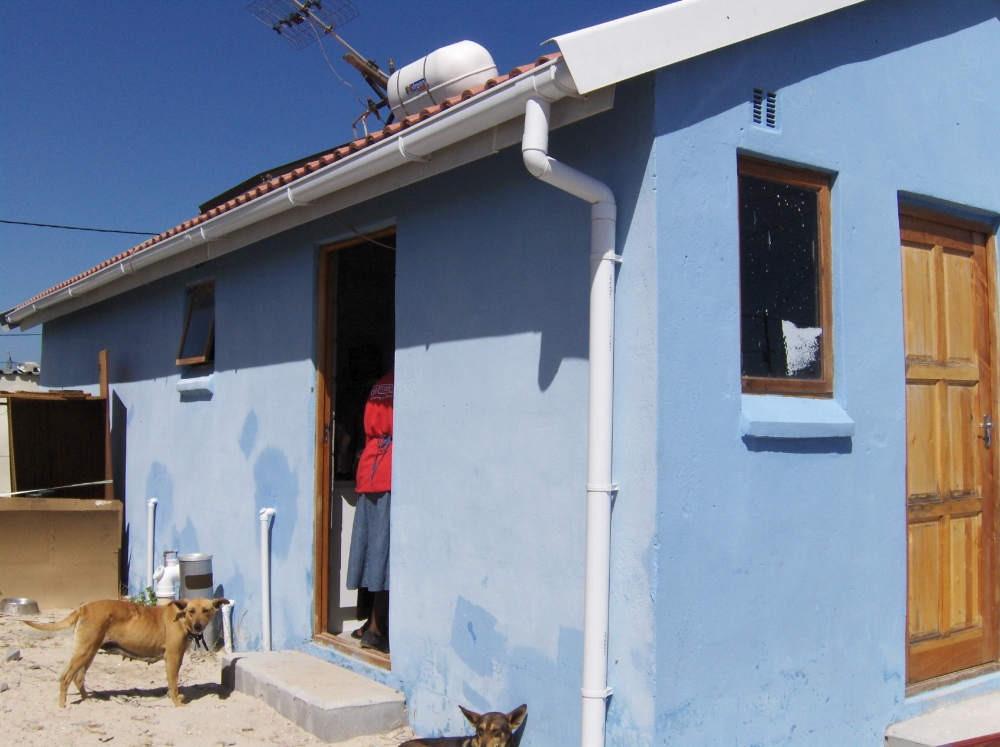 Betoniertes Haus in Township